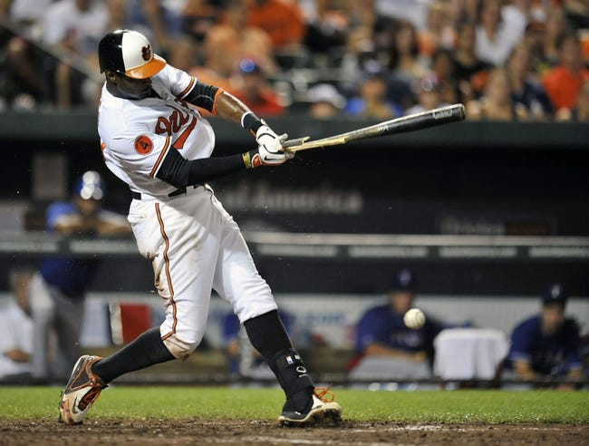 Jul 10, 2013; Baltimore, MD, USA; Baltimore Orioles center fielder Adam Jones (10) breaks his bat as he grounds out in the eighth inning against the Texas Rangers at Oriole Park at Camden Yards. The Orioles defeated the Rangers 6-1. Mandatory Credit: Joy R. Absalon-USA TODAY Sports