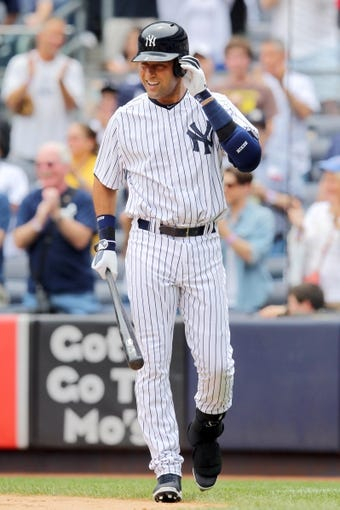 Jul 11, 2013; Bronx, NY, USA; New York Yankees designated hitter Derek Jeter (2) walks to the plate for his first at bat during the first inning of a game against the Kansas City Royals at Yankee Stadium. Mandatory Credit: Brad Penner-USA TODAY Sports