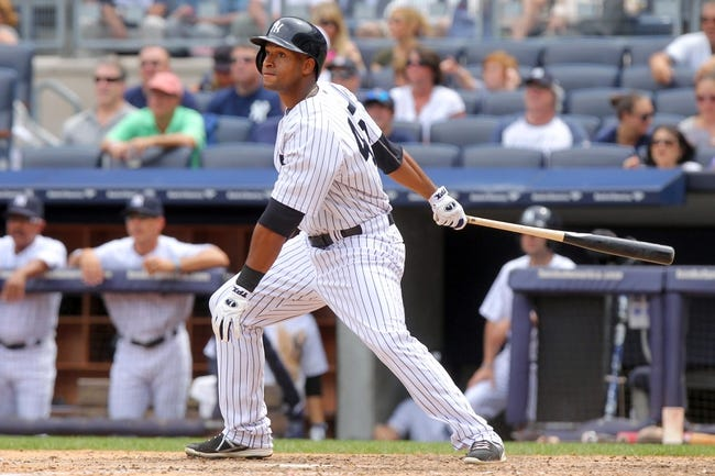 Jul 11, 2013; Bronx, NY, USA; New York Yankees left fielder Zoilo Almonte (45) hits an RBI single against the Kansas City Royals during the fifth inning of a game at Yankee Stadium. Mandatory Credit: Brad Penner-USA TODAY Sports