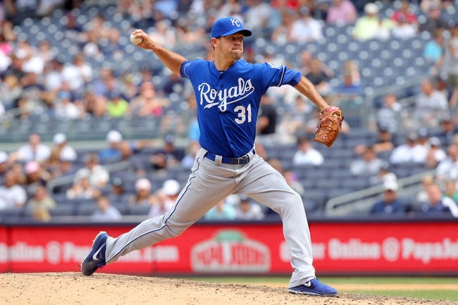 Jul 11, 2013; Bronx, NY, USA; Kansas City Royals relief pitcher Louis Coleman (31) pitches against the New York Yankees during the eighth inning of a game at Yankee Stadium. Mandatory Credit: Brad Penner-USA TODAY Sports