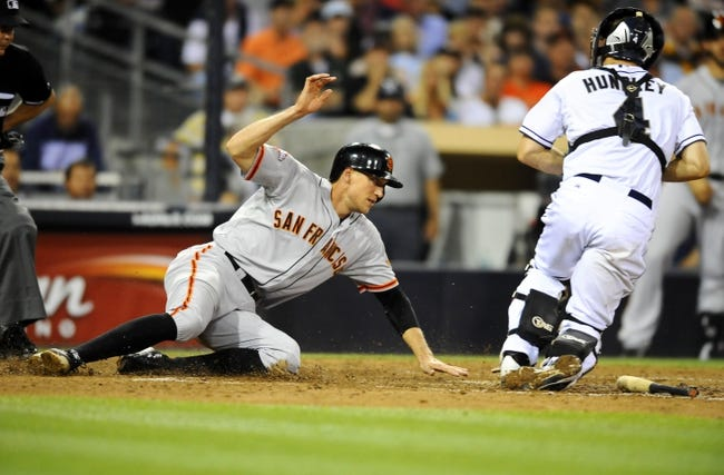 Jul 11, 2013; San Diego, CA, USA; San Francisco Giants right fielder Hunter Pence (8) is tagged out by San Diego Padres catcher Nick Hundley (4) trying to score during the sixth inning at Petco Park. Mandatory Credit: Christopher Hanewinckel-USA TODAY Sports