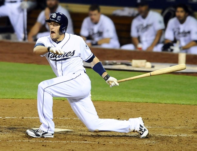 Jul 11, 2013; San Diego, CA, USA; San Diego Padres center fielder Chris Denorfia (13) reacts after fouling a ball off his foot during the sixth inning against the San Francisco Giants at Petco Park. Mandatory Credit: Christopher Hanewinckel-USA TODAY Sports