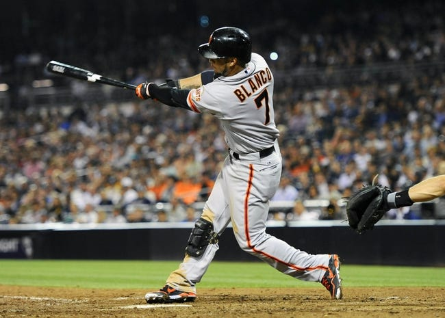 Jul 11, 2013; San Diego, CA, USA; San Francisco Giants center fielder Gregor Blanco (7) hits an RBI ground rule double during the eighth inning against the San Diego Padres at Petco Park. Mandatory Credit: Christopher Hanewinckel-USA TODAY Sports