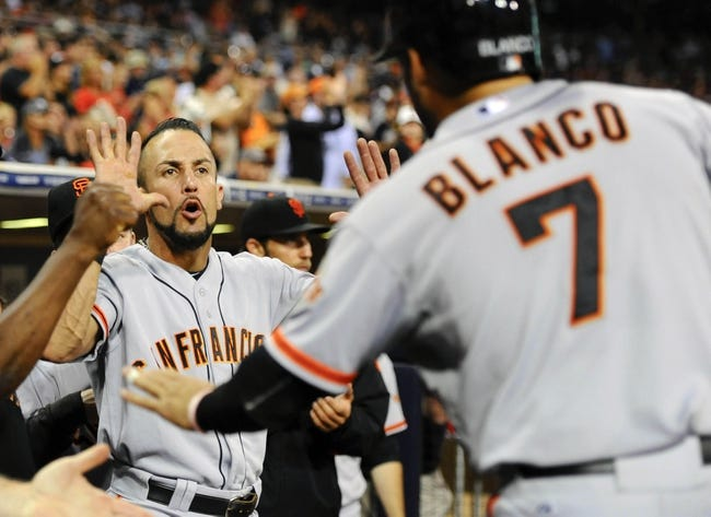 Jul 11, 2013; San Diego, CA, USA; San Francisco Giants left fielder Andres Torres (56) congratulates center fielder Gregor Blanco (7) after scoring during the eighth inning against the San Diego Padres at Petco Park. Mandatory Credit: Christopher Hanewinckel-USA TODAY Sports