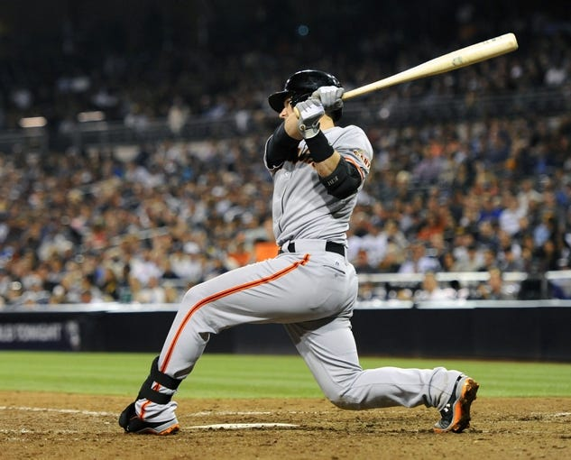 Jul 11, 2013; San Diego, CA, USA; San Francisco Giants catcher Buster Posey (28) singles home a run during the eighth inning against the San Diego Padres at Petco Park. Mandatory Credit: Christopher Hanewinckel-USA TODAY Sports