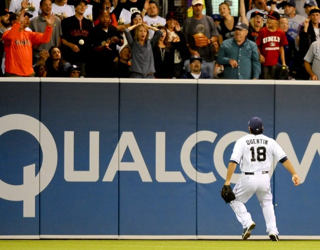 Jul 11, 2013; San Diego, CA, USA; San Diego Padres left fielder Carlos Quentin (18) watches a ball bounce over the fence for a ground rule double during the eighth inning against the San Francisco Giants at Petco Park. Mandatory Credit: Christopher Hanewinckel-USA TODAY Sports