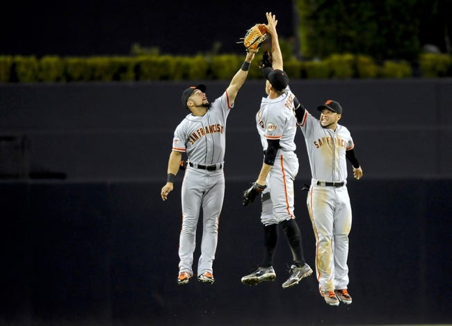 Jul 11, 2013; San Diego, CA, USA; San Francisco Giants left fielder Andres Torres (left), right fielder Hunter Pence (center) and center fielder Gregor Blanco (7) celebrate after a 4-2 win against the San Diego Padres at Petco Park. Mandatory Credit: Christopher Hanewinckel-USA TODAY Sports