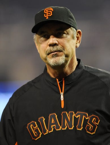 Jul 11, 2013; San Diego, CA, USA; San Francisco Giants manager Bruce Bochy (15) after a 4-2 win against the San Diego Padres at Petco Park. Mandatory Credit: Christopher Hanewinckel-USA TODAY Sports