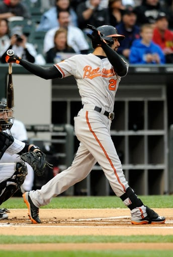 Jul 2, 2013; Chicago, IL, USA; Baltimore Orioles right fielder Nick Markakis (21) follows through on a swing during the game against the Chicago White Sox at U.S. Cellular Field. Mandatory Credit: Reid Compton-USA TODAY Sports