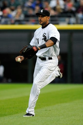 Jul 2, 2013; Chicago, IL, USA; Chicago White Sox right fielder Alex Rios (51) makes a throw to first base during the game against the Baltimore Orioles at U.S. Cellular Field. Mandatory Credit: Reid Compton-USA TODAY Sports