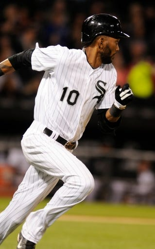 Jul 2, 2013; Chicago, IL, USA; Chicago White Sox shortstop Alexei Ramirez (10) rounds first base during the game against the Baltimore Orioles at U.S. Cellular Field. Mandatory Credit: Reid Compton-USA TODAY Sports