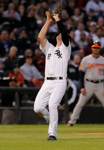 Jul 2, 2013; Chicago, IL, USA; Chicago White Sox third baseman Conor Gillaspie (12) makes an out during the game against the Baltimore Orioles at U.S. Cellular Field. Mandatory Credit: Reid Compton-USA TODAY Sports