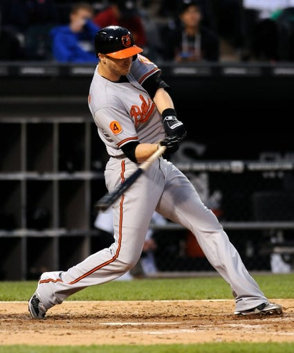 Jul 2, 2013; Chicago, IL, USA; Baltimore Orioles designated hitter Nolan Reimold (14) during the game against the Chicago White Sox at U.S. Cellular Field. Mandatory Credit: Reid Compton-USA TODAY Sports