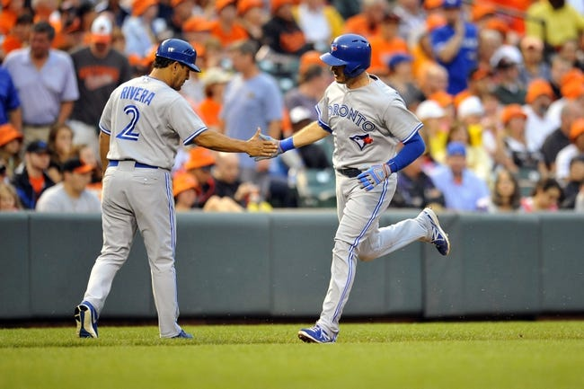 Jul 12, 2013; Baltimore, MD, USA; Toronto Blue Jays catcher J.P. Arencibia (9) is congratulated by third base coach Luis Rivera (2) after hitting a two-run home run in the second inning against the Baltimore Orioles at Oriole Park at Camden Yards. Mandatory Credit: Joy R. Absalon-USA TODAY Sports