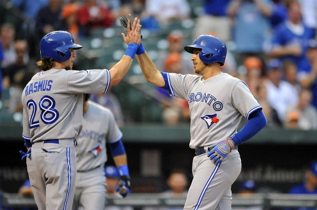 Jul 12, 2013; Baltimore, MD, USA; Toronto Blue Jays catcher J.P. Arencibia (9) is congratulated by Colby Rasmus (28) after hitting a two-run home run in the second inning against the Baltimore Orioles at Oriole Park at Camden Yards. Mandatory Credit: Joy R. Absalon-USA TODAY Sports
