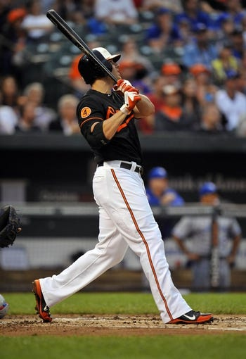 Jul 12, 2013; Baltimore, MD, USA; Baltimore Orioles first baseman Chris Davis (19) hits a two-run home run in the second inning against the Toronto Blue Jays at Oriole Park at Camden Yards. Mandatory Credit: Joy R. Absalon-USA TODAY Sports