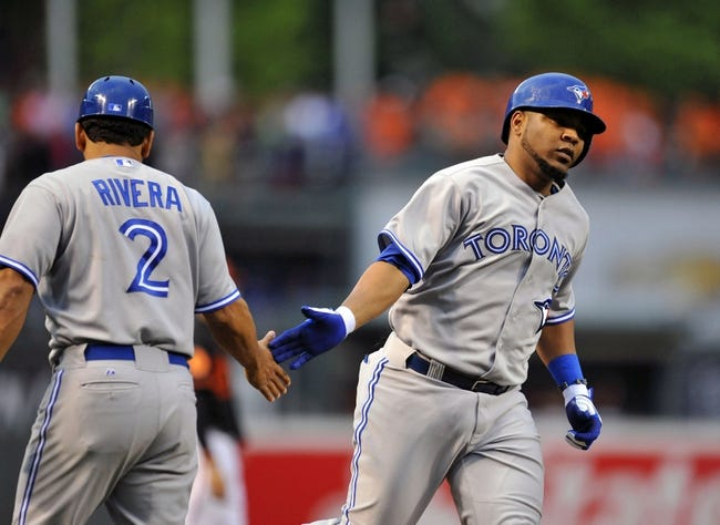 Jul 12, 2013; Baltimore, MD, USA; Toronto Blue Jays first baseman Edwin Encarnacion (10) is congratulated by third base coach Luis Rivera (2) after hitting a solo home run in the third inning against the Baltimore Orioles at Oriole Park at Camden Yards. Mandatory Credit: Joy R. Absalon-USA TODAY Sports