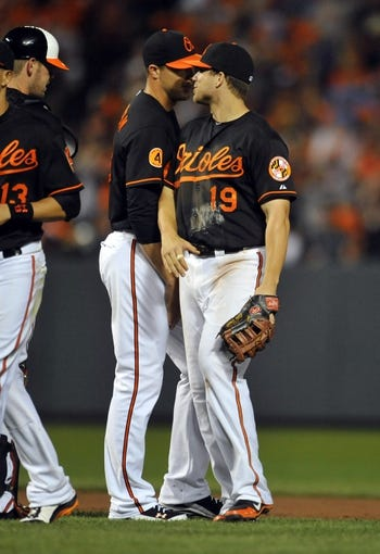Jul 12, 2013; Baltimore, MD, USA; Baltimore Orioles teammates Chris Davis (right) and Jim Johnson (left) after a game against the Toronto Blue Jays at Oriole Park at Camden Yards. The Orioles defeated the Blue Jays 8-5. Mandatory Credit: Joy R. Absalon-USA TODAY Sports