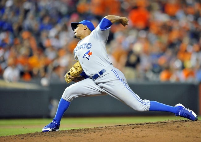Jul 12, 2013; Baltimore, MD, USA; Toronto Blue Jays pitcher Juan Perez (57) throws in the seventh inning against the Baltimore Orioles at Oriole Park at Camden Yards. The Orioles defeated the Blue Jays 8-5. Mandatory Credit: Joy R. Absalon-USA TODAY Sports