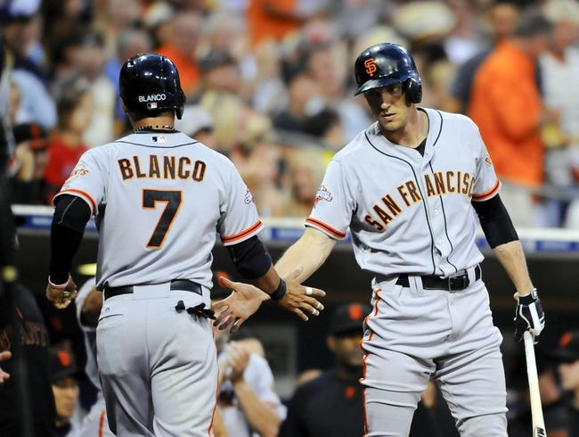 Jul 12, 2013; San Diego, CA, USA; San Francisco Giants center fielder Gregor Blanco (7) is congratulated by right fielder Hunter Pence (8) after scoring during the third inning against the San Diego Padres at Petco Park. Mandatory Credit: Christopher Hanewinckel-USA TODAY Sports