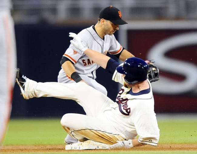 Jul 12, 2013; San Diego, CA, USA; San Diego Padres starting pitcher Sean O'Sullivan (59) slides safely into second base ahead of a play by San Francisco Giants second baseman Marco Scutaro (19) during the third inning at Petco Park. Mandatory Credit: Christopher Hanewinckel-USA TODAY Sports