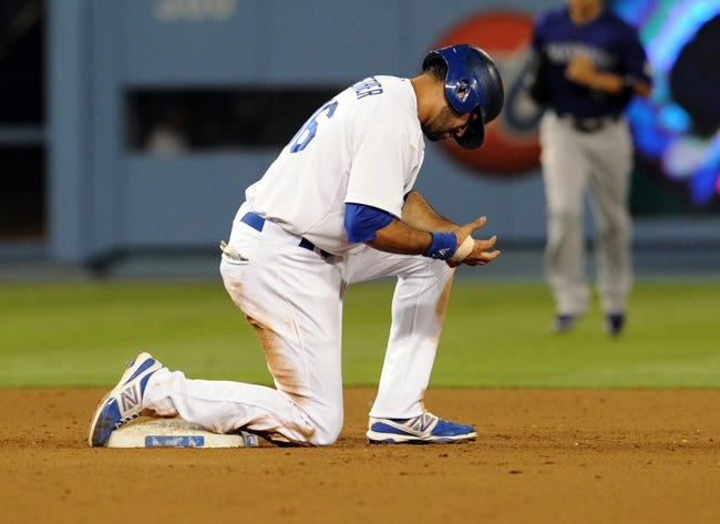 Jul 12, 2013; Los Angeles, CA, USA;  Los Angeles Dodgers right fielder Andre Ethier (16) was thrown out at second in the seventh inning of the game against the Colorado Rockies at Dodger Stadium.Mandatory Credit: Jayne Kamin-Oncea-USA TODAY Sports