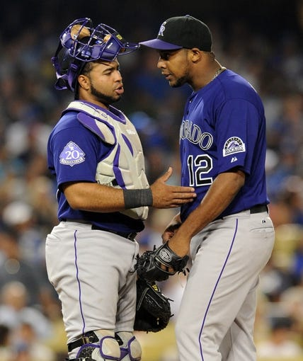 Jul 12, 2013; Los Angeles, CA, USA;  Colorado Rockies catcher Wilin Rosario (20) talks with starting pitcher Juan Nicasio (12) during the game against the Los Angeles Dodgers at Dodger Stadium.Mandatory Credit: Jayne Kamin-Oncea-USA TODAY Sports