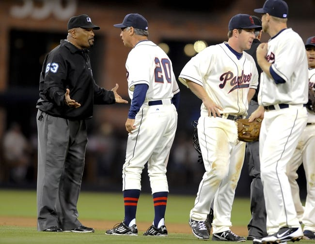 Jul 12, 2013; San Diego, CA, USA; San Diego Padres manager Bud Black (20) argues a call with second base umpire Laz Diaz (63) after a play during the seventh inning against the San Francisco Giants at Petco Park. Mandatory Credit: Christopher Hanewinckel-USA TODAY Sports