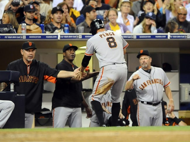 Jul 12, 2013; San Diego, CA, USA; San Francisco Giants right fielder Hunter Pence (8) is congratulated by manager Bruce Bochy (15) after scoring during the sixth inning against the San Diego Padres at Petco Park. Mandatory Credit: Christopher Hanewinckel-USA TODAY Sports