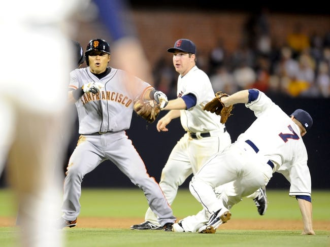 Jul 12, 2013; San Diego, CA, USA; San Francisco Giants left fielder Kensuke Tanaka (37) reacts after a fielders interference by San Diego Padres third baseman Chase Headley (7) in a rundown during the seventh inning at Petco Park. Mandatory Credit: Christopher Hanewinckel-USA TODAY Sports