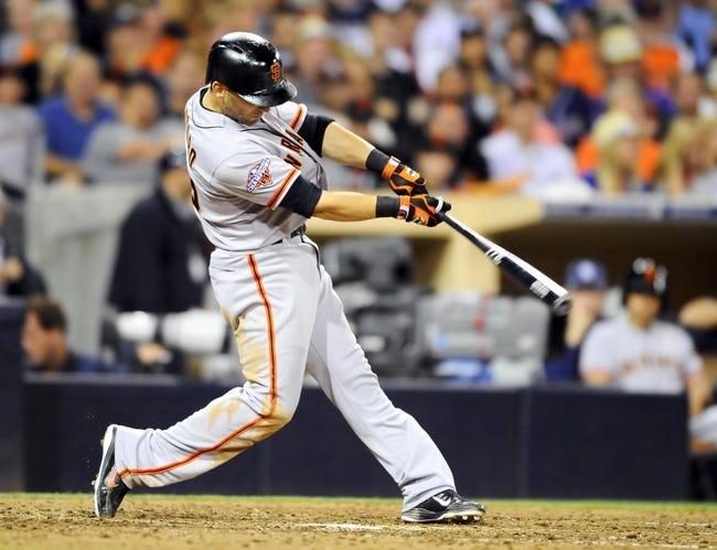 Jul 12, 2013; San Diego, CA, USA; San Francisco Giants second baseman Marco Scutaro (19) hits an RBI single during the seventh inning against the San Diego Padres at Petco Park. Mandatory Credit: Christopher Hanewinckel-USA TODAY Sports