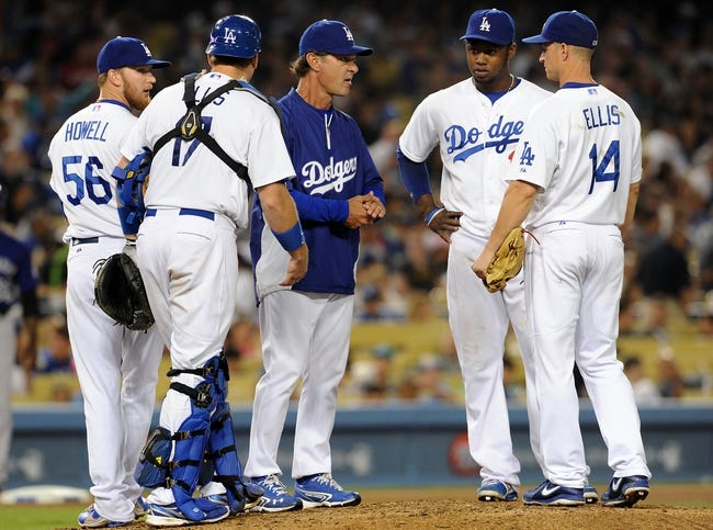 Jul 12, 2013; Los Angeles, CA, USA;  Los Angeles Dodgers manager Don Mattingly (8) pulls pitcher relief pitcher J.P. Howell (56) in the seventh inning of the game against the Colorado Rockies at Dodger Stadium. Rockies won 3-0. Mandatory Credit: Jayne Kamin-Oncea-USA TODAY Sports