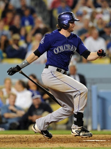 Jul 12, 2013; Los Angeles, CA, USA;  Colorado Rockies right fielder Charlie Blackmon (19) at bat during the game against the Los Angeles Dodgers at Dodger Stadium. Rockies won 3-0. Mandatory Credit: Jayne Kamin-Oncea-USA TODAY Sports