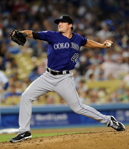 Jul 12, 2013; Los Angeles, CA, USA;  Colorado Rockies relief pitcher Rex Brothers (49) in the eighth inning of the game against the Los Angeles Dodgers at Dodger Stadium. Rockies won 3-0. Mandatory Credit: Jayne Kamin-Oncea-USA TODAY Sports