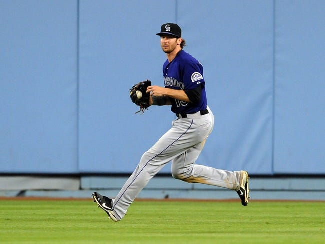 Jul 12, 2013; Los Angeles, CA, USA;  Colorado Rockies right fielder Charlie Blackmon (19) makes a play during the game against the Los Angeles Dodgers at Dodger Stadium. Rockies won 3-0. Mandatory Credit: Jayne Kamin-Oncea-USA TODAY Sports