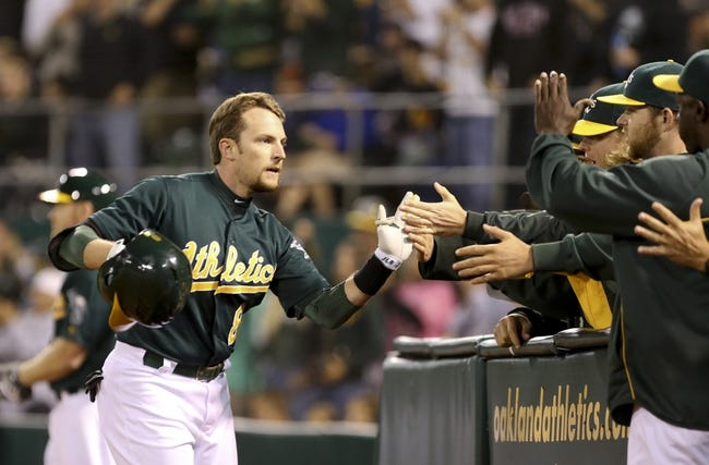 Jul 12, 2013; Oakland, CA, USA; Oakland Athletics shortstop Jed Lowrie (8) high fives his teammates after hitting a solo home run against the Boston Red Sox during the sixth inning at O.co Coliseum. Mandatory Credit: Kelley L Cox-USA TODAY Sports