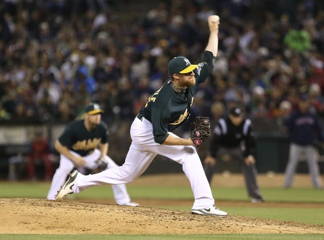 Jul 12, 2013; Oakland, CA, USA; Oakland Athletics relief pitcher Sean Doolittle (62) pitches the ball against the Boston Red Sox during the eighth inning at O.co Coliseum. Mandatory Credit: Kelley L Cox-USA TODAY Sports
