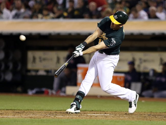 Jul 12, 2013; Oakland, CA, USA; Oakland Athletics designated hitter Seth Smith (15) hits a double against the Boston Red Sox during the fifth inning at O.co Coliseum. Mandatory Credit: Kelley L Cox-USA TODAY Sports