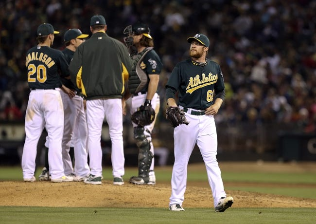 Jul 12, 2013; Oakland, CA, USA; Oakland Athletics relief pitcher Sean Doolittle (62) is replaced by manager Bob Melvin (6) against the Boston Red Sox during the eighth inning at O.co Coliseum. Mandatory Credit: Kelley L Cox-USA TODAY Sports