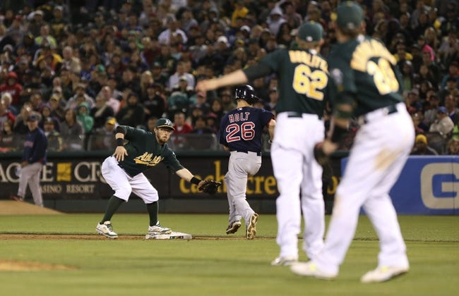 Jul 12, 2013; Oakland, CA, USA; Oakland Athletics second baseman Eric Sogard (28) makes the out against Boston Red Sox third baseman Brock Holt (26) during the eighth inning at O.co Coliseum. Mandatory Credit: Kelley L Cox-USA TODAY Sports
