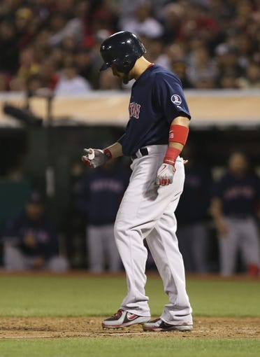 Jul 12, 2013; Oakland, CA, USA; Boston Red Sox right fielder Shane Victorino (18) reacts after being hit by pitch against the Oakland Athletics during the eighth inning at O.co Coliseum. Mandatory Credit: Kelley L Cox-USA TODAY Sports