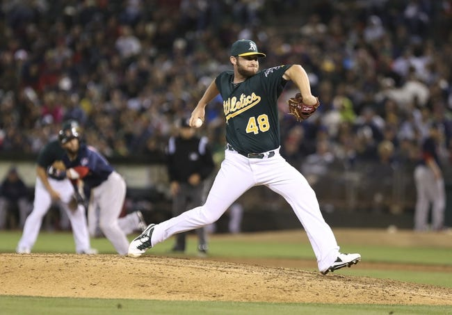 Jul 12, 2013; Oakland, CA, USA; Oakland Athletics relief pitcher Ryan Cook (48) pitches the ball against the Boston Red Sox during the eighth inning at O.co Coliseum. Mandatory Credit: Kelley L Cox-USA TODAY Sports