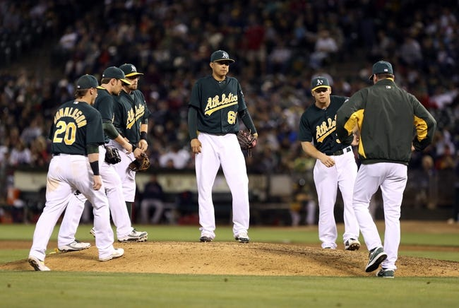 Jul 12, 2013; Oakland, CA, USA; Oakland Athletics manager Bob Melvin (6) visits relief pitcher Jesse Chavez (60) on the mound during the ninth inning against the Boston Red Sox at O.co Coliseum. Mandatory Credit: Kelley L Cox-USA TODAY Sports