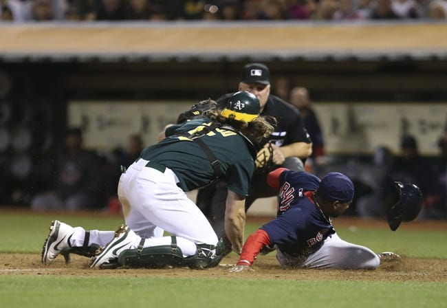 Jul 12, 2013; Oakland, CA, USA; Oakland Athletics catcher John Jaso (5) tags out Boston Red Sox pinch runner Jackie Bradley Jr. (44) during the ninth inning at O.co Coliseum. Mandatory Credit: Kelley L Cox-USA TODAY Sports
