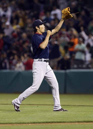 Jul 12, 2013; Oakland, CA, USA; Boston Red Sox relief pitcher Koji Uehara (19) celebrates after the final out against the Oakland Athletics at O.co Coliseum. The Boston Red Sox defeated the Oakland Athletics 4-2. Mandatory Credit: Kelley L Cox-USA TODAY Sports