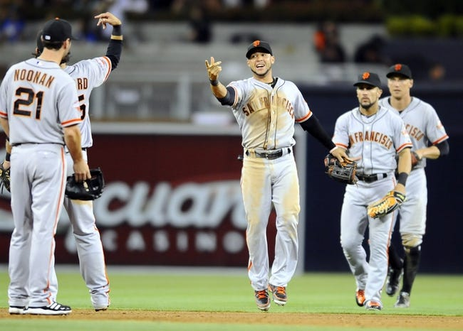 Jul 12, 2013; San Diego, CA, USA; San Francisco Giants center fielder Gregor Blanco (7) celebrates with teammates a 10-1 win against the San Diego Padres at Petco Park. Mandatory Credit: Christopher Hanewinckel-USA TODAY Sports
