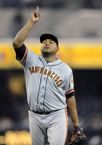 Jul 12, 2013; San Diego, CA, USA; San Francisco Giants relief pitcher Jean Machi (63) celebrates after a 10-1 win against the San Diego Padres at Petco Park. Mandatory Credit: Christopher Hanewinckel-USA TODAY Sports