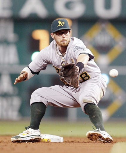 Jul 9, 2013; Pittsburgh, PA, USA; Oakland Athletics second baseman Eric Sogard (28) takes a throw at the base against the Pittsburgh Pirates during the third inning at PNC Park. The Oakland Athletics won 2-1. Mandatory Credit: Charles LeClaire-USA TODAY Sports