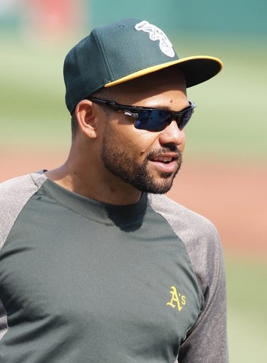 Jul 9, 2013; Pittsburgh, PA, USA; Oakland Athletics center fielder Coco Crisp (4) on the field before playing the Pittsburgh Pirates at PNC Park. The Oakland Athletics won 2-1. Mandatory Credit: Charles LeClaire-USA TODAY Sports