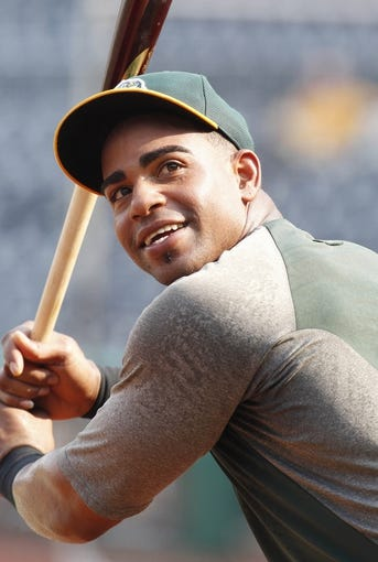 Jul 9, 2013; Pittsburgh, PA, USA; Oakland Athletics left fielder Yoenis Cespedes (52) at the batting cage before playing the Pittsburgh Pirates at PNC Park. The Oakland Athletics won 2-1. Mandatory Credit: Charles LeClaire-USA TODAY Sports